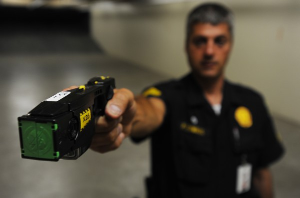 Bangor police Sgt. Paul Edwards displays a Taser 26 at the Bangor Police station on Wednesday, July 29, 2009.