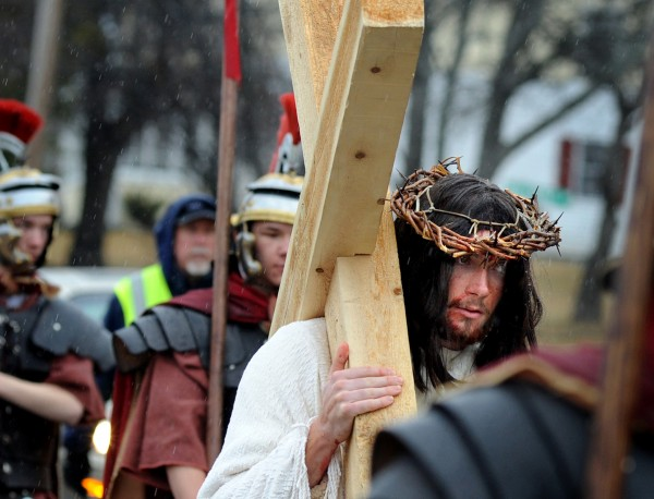 Jesus, portrayed by Hampden Academy senior Jake Maltz, carries the cross down North Main Street in Brewer during the third annual Way of the Cross Palm Sunday Community Procession. About 80 parishioners from St. Paul the Apostle Parish took part in the pilgrimage of prayer in preparation for Easter. The procession began at St. Joseph Catholic Church in Brewer and ended at St. John Catholic Church in Bangor.