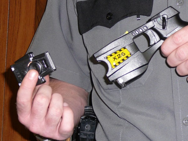 Newport Police Officer Jeremy Flynn demonstrates how a Taser is used, by inserting the cartridge that contains the wires and charge into the &quotgun&quot in this July 2007 photo.