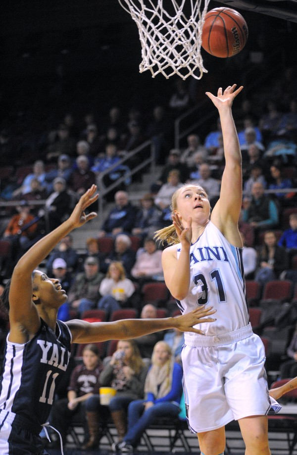 The University of Maine's Liz Wood (right) goes up for a shot over Yale University's Zenab Keita during their game at the Cross Insurance Center in Bangor in January.