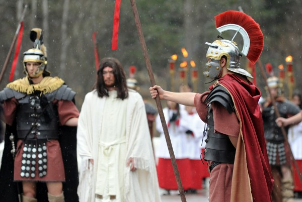 Jesus is condemned to death in the first station of the third annual Way of the Cross Palm Sunday Community Procession. About 80 parishioners from St. Paul the Apostle Parish took part in the pilgrimage of prayer in preparation for Easter. The procession began at St. Joseph Catholic Church in Brewer and ended at St. John Catholic Church in Bangor.