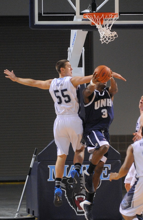 The University of Maine's Garet Beal (left) tries to block a shot by New Hampshire's Jacoby Armstrong during a game in March at the Cross Insurance Center in Bangor.