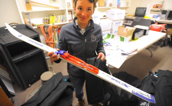 Lauren Jacobs, a community development coach in the central Maine area for the Maine Winter Sports Center, picks up cross-country skis at the Bangor Parks and Recreation building earlier this month.
