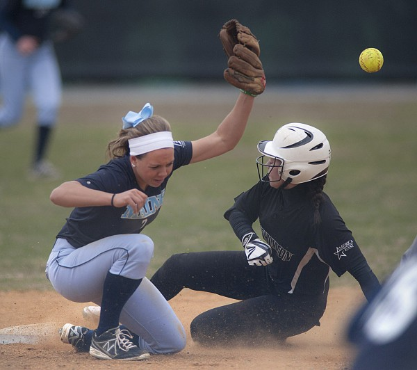 Binghamton runner Gabby Bracchi slides in to second as the ball gets away from the University of Maine's Felicia Lennon (7) in the third inning of Game 1 in Saturday's America East softball doubleheader in Orono.