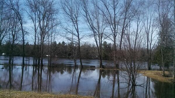 A lonely bench on Hathaway Road in Mattawamkeag sits along the rising Mattawamkeag River on Friday.