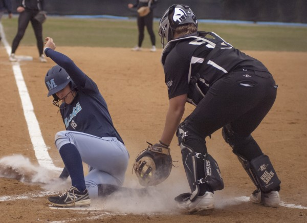 Maine's EmJ  Fogel (18) slides into home plate for a run in the second inning of their game against Binghamton in Orono on Saturday.