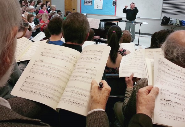 Director Lucas Richman conducts the Oratorio Society and University Singers in the bass section in 1944 Hall in Orono on Monday.