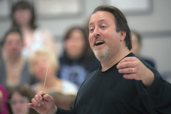 Director Lucas Richman rehearses for an upcoming Bangor Symphony Orchestra production with the Oratorio Society and University Singers in 1944 Hall in Orono on Monday.