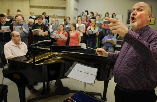 Ludlow Hallman (right) leads the combined choir with Clayton W. Smith (at piano) for &quotMarie-Magdeleine&quot during rehearsal in this April 2009 file photo.