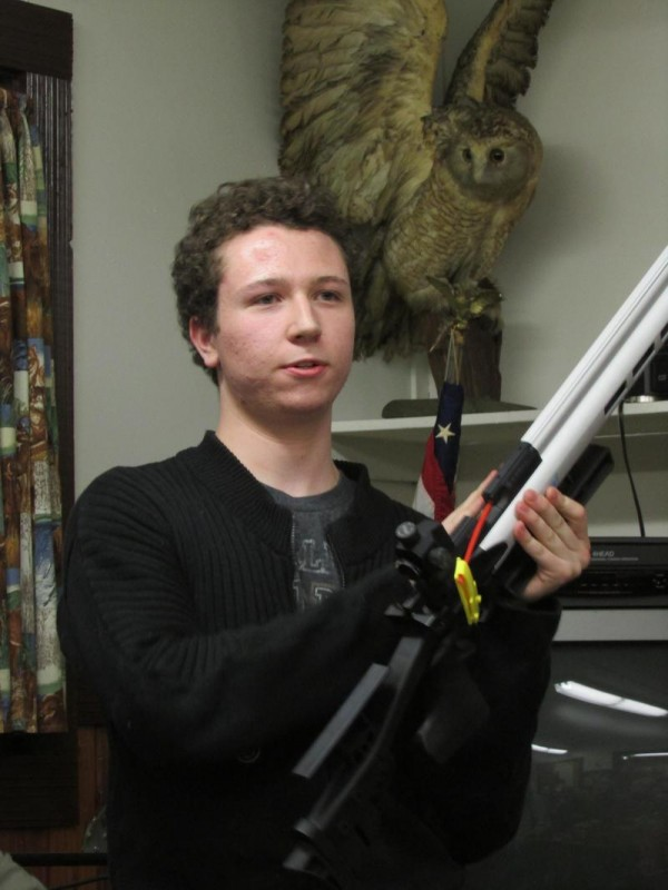 Maine junior state air rifle champion Brandon Bryer, 17, of Scarborough, demonstrates his competition rifle at a Spurwink Rod and Gun Club meeting on April 3 in Cape Elizabeth.