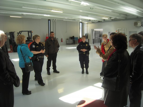 Port Director Patricia Scull, (right center), and Supervisor Amy Michaud, explain to municipal officials and Acadian Congress committee members how the cargo bay at the Port of Entry between St. Leonard, N.B., and Van Buren, Maine, will be used as a processing center for busloads of visitors during the World Acadian Congress in August.