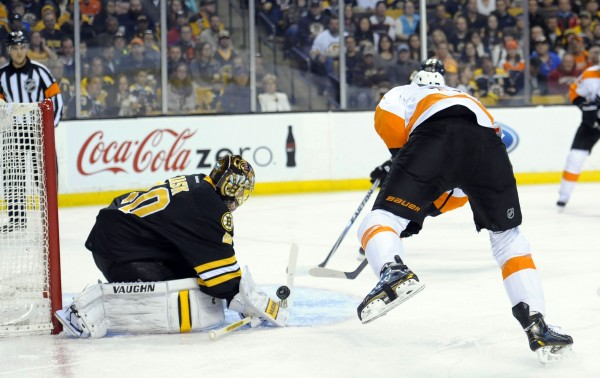 Boston Bruins goalie Tuukka Rask (40) makes a save on Philadelphia Flyers right wing Wayne Simmonds (17) during the first period Saturday at TD Banknorth Garden in Boston.