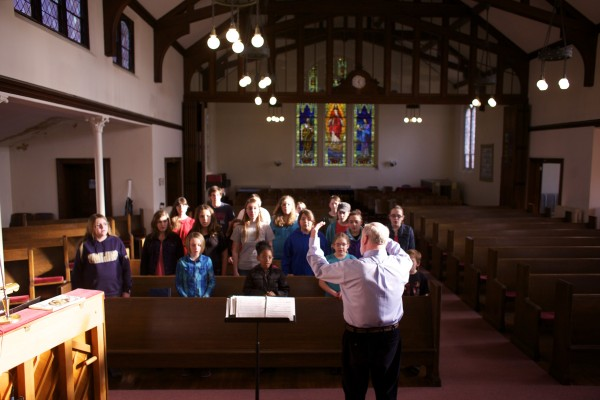 Robert Ludwig directs students belonging to the Bangor Area Children's Choir during a practice at the First Baptist Church in Bangor Tuesday afternoon.