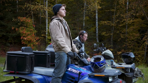 Dominic (Callen McAuliffe) and Casper (Emory Cohen) hanging out on ATVs, a scene from &quotBeneath the Harvest Sky,&quot shot in Van Buren.