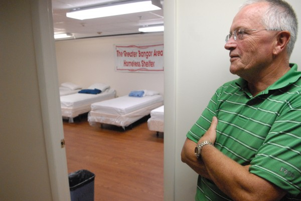 In this August 2010 file photo, Dennis Marble, director of the Bangor Area Homeless Shelter, looks inside the facility's basement bedroom. Marble said Friday that the shelter is running out of food.