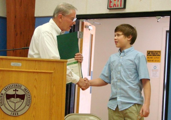 North Yarmouth Town Meeting on April 12 started with Steve Palmer, chairman of the Board of Selectman, honoring Greely Middle School student C.J. Bates for being a winner in &quotIf I led my community ...,&quot a statewide seventh-grade essay contest held by the Maine Municipal Association.