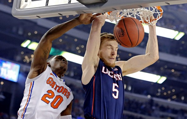 Connecticut's Niels Giffey (5) gets past Florida's Michael Frazier II to score as Connecticut beat Florida 63-53 in the first semifinal game of the Final Four at AT&T Stadium Saturday night in Arlington, Texas.