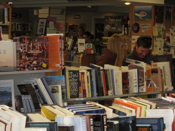Bostonians Rachel Ackerman (left) and Mike Bailey browse at Longfellow Books in downtown Portland.