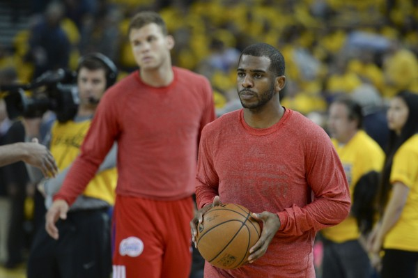 Los Angeles Clippers guard Chris Paul (3, right) and forward Blake Griffin (32, left) warm up before game four of the first round of the 2014 NBA Playoffs against the Golden State Warriors at Oracle Arena. Team members their warm-up jerseys inside-out to hide the team name to protest racist comments made by the team's owner.