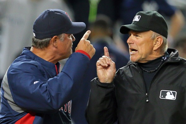 Boston Red Sox manager John Farrell (53) argues with umpire Bob Davidson (61) after being thrown out of the game against the New York Yankees during the fourth inning at Yankee Stadium on April 13.