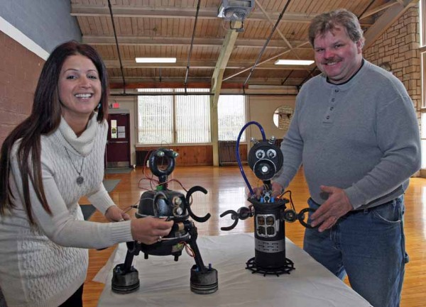 Sandra Donnelly, left, and Russell Stairs are collaborating to offer a youth art project at the Houlton Recreation Department on making robots. The program is a combination of art, math, history and science.