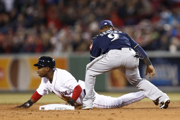 Boston's Jonathan Herrera (10) is tagged out at second base by Milwaukee Brewers shortstop Jean Segura at Fenway Park in Boston Saturday night.
