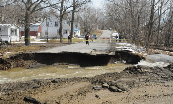 The culvert was removed after it was washed out by flood on Lincoln Street in Dexter Thursday.