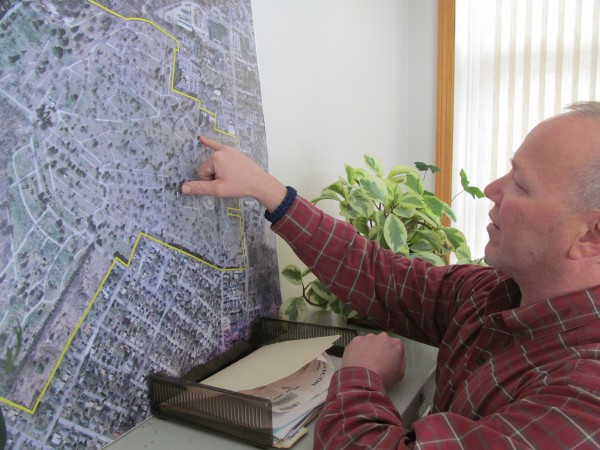 Joe Dumais, Portland's cemetery superintendent, points out on a map where the city's historic Evergreen Cemetery would be expanded. The approximately 180-acre cemetery would get space for 800-1,000 graves and a new columbarium for the interment of cremation remains in the project.