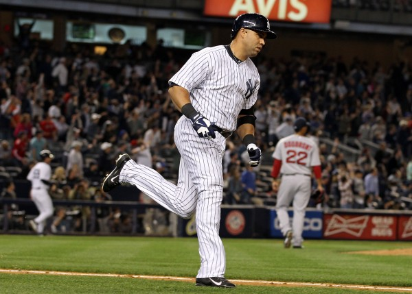 New York's Carlos Beltran (36) runs up the first base line after hitting a two-run home run off of Boston Red Sox starting pitcher Felix Doubront (22) during the third inning at Yankee Stadium in New York Sunday night.
