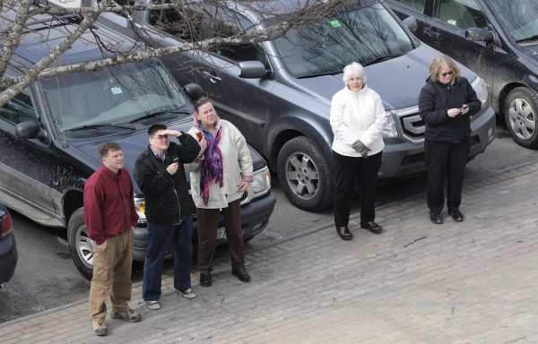 Onlookers watch the unveiling of the new copper roof on the Bangor Public Library on Thursday.