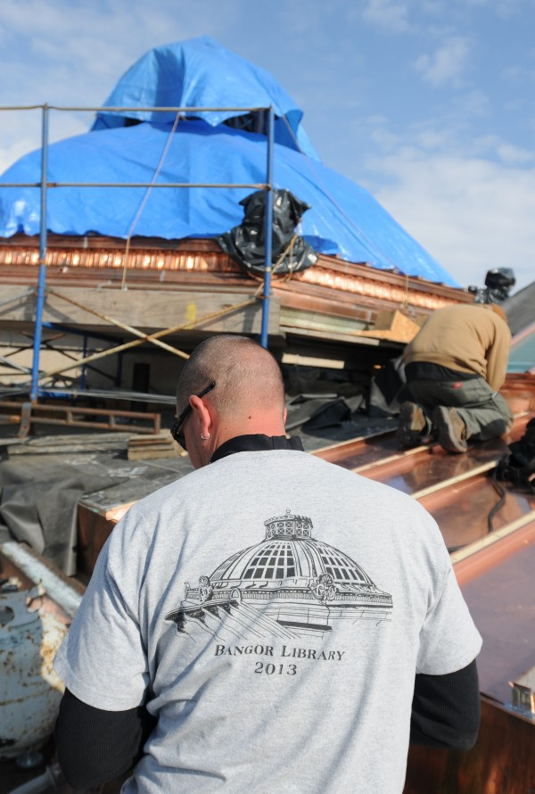 Coppersmith Bobby Alley wears a shirt depicting the finished Bangor Public Library dome which was revealed on Thursday.