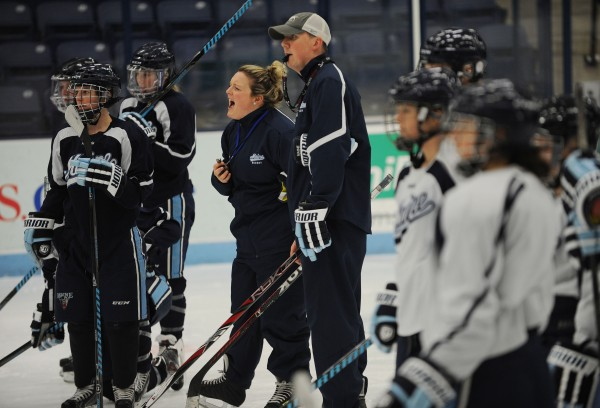 University of Maine women's hockey coaches Sara Simard Reichenbach and Richard Reichenbach give out instructions to their team during a practice in November 2013 at Alfond Arena. The Reichenbachs, who are married, are the interim coaches of the University of Maine women's hockey team.