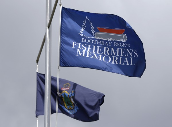 Flags fly at the fishermen's memorial in Boothbay Harbor on Sunday.