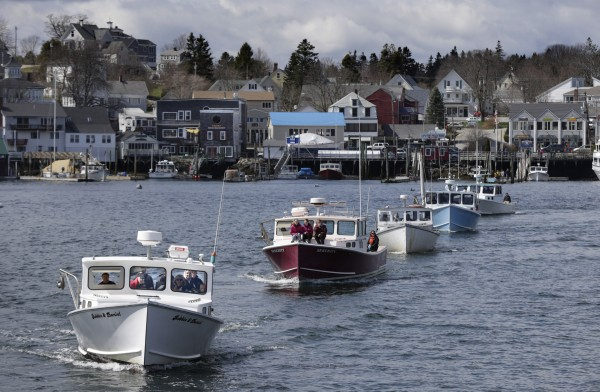 Commercial fishing boats arrive for the Blessing of the Fleet at Boothbay Harbor on Sunday.