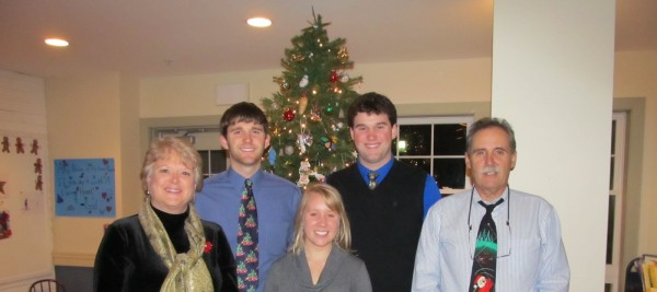 Boston Marathon runner Dacie Manion (center) smiles in a Christmas photograph with, from left to right, Shelley Gilman, Chris Gilman, Ryan Gilman and Matt Gilman. Manion is running with a team from the Dana-Farber Cancer Institute to honor the life of Matt Gilman, who died last fall after a long fight with the disease.