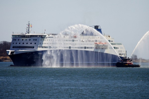 The Nova Star pulls into Portland Harbor with a fireboat escort on Thursday. The new Portland to Nova Scotia ferry will begin daily service in May.