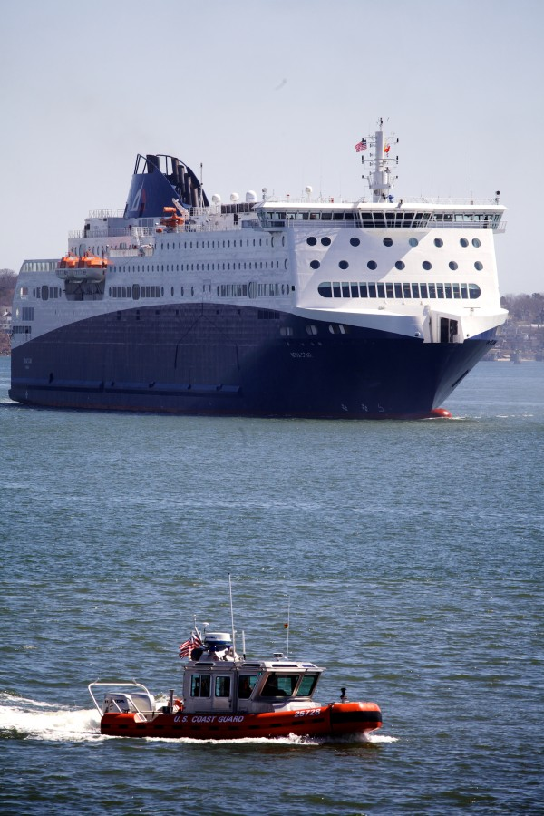 A small U.S. Coast Guard vessel darts in front of the Nova Star as it arrives in Portland for the first time on Thursday. The ferry will start making daily voyages to Nova Scotia starting in May.