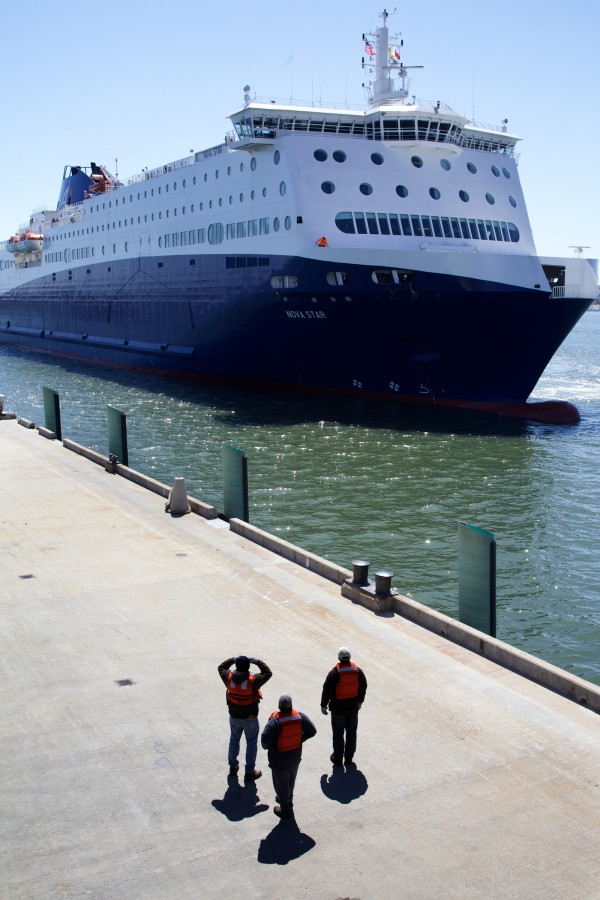 Dockworkers watch the Nova Star approach the Ocean Gateway Terminal in Portland on Thursday.