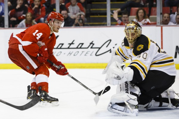 Detroit Red Wings center Gustav Nyquist (14) scores a goal on Boston Bruins goalie Tuukka Rask (40) in the third period at Joe Louis Arena on April 2.
