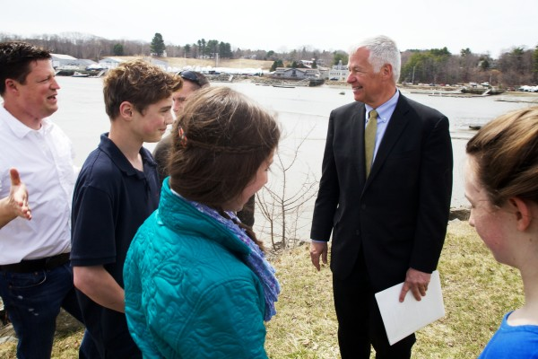U.S. Rep. Mike Michaud speaks with Yarmouth middle school students on the waterfront on Tuesday about their study of invasive green crabs.