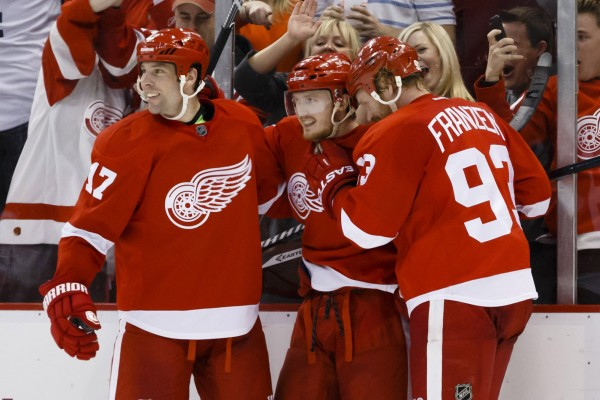 Detroit Red Wings center Gustav Nyquist (center) receives congratulations from left wing Johan Franzen (93) and center David Legwand (17) after scoring in the third period against the Boston Bruins at Joe Louis Arena on April 2.