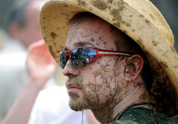Alpha Delta sophomore Judson Walden, oozeball chairman, is covered in mud on the sidelines of the oozeball pit on Wednesday. The Alpha Delta fraternity started the oozeball tradition as a Maine Day festivity and 2014 marked the 31st year of fun in the mud.