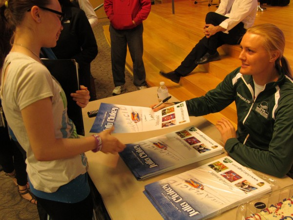 Julia Clukey, a member of the 2010 U.S. Olympic luge team and an Augusta native, signs autographs for Biddeford High School seniors after an assembly on Tuesday morning.