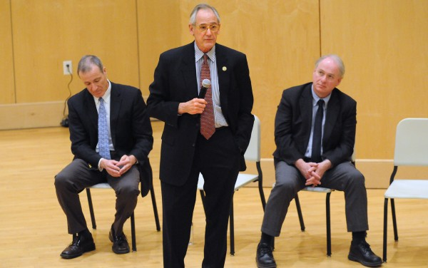 UMS trustees Samuel Collins (from left) and Gregory Johnson, and University of Maine System Chancellor James Page speak during a forum at the Orono campus discussing the budget cuts.