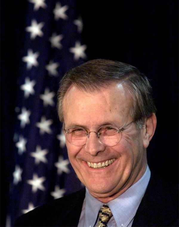 Donald Rumsfeld reacts after President-elect Bush's announcement in Washington Thursday, Dec. 28, 2000, nominating Rumsfeld to be his secretary of defense.