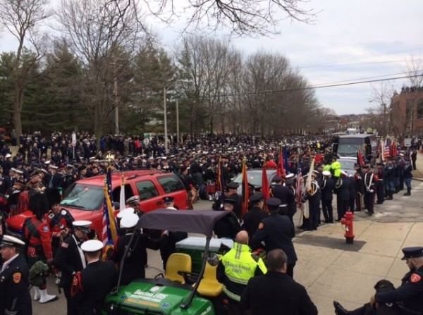 Members of the Maine Public Safety Pipe and Drum Corps joined some 400 other bagpipers and drummers to lead the funeral procession to St. Patrick's Church on Wednesday.