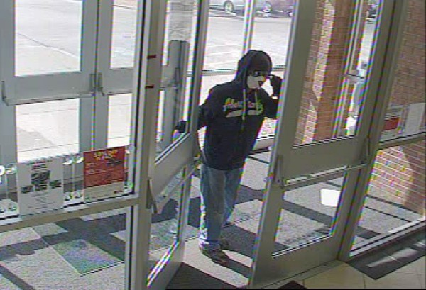 These surveillance system images show the suspect in a robbery Thursday afternoon at Maine Saving Federal Credit Union on Broadway.