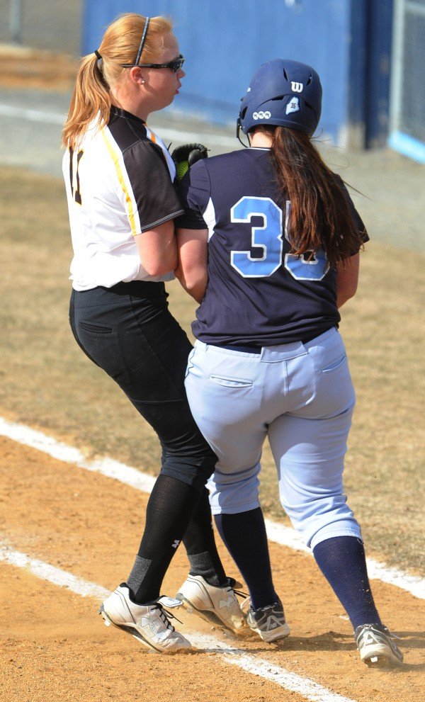 University of Maryland Baltimore County pitcher Taylor Hall collides with UMaine runner Nikki Byron after forcing her out at first base during fifth-inning action on Friday at Orono.