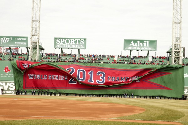 A 2013 World Series championship banner for the Boston Red Sox is unfurled on the Green Monster during pre-game ceremonies before the start of the game against the Milwaukee Brewers at Fenway Park on Friday.