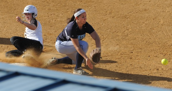 University of Maryland Baltimore County's Jordan Sganga slides into third base safely as UMaine's Shelby Obert scoops up the throw during sixth-inning action on Friday at Orono.
